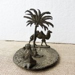 Vintage brass plate with Bedouin camel and palm tree